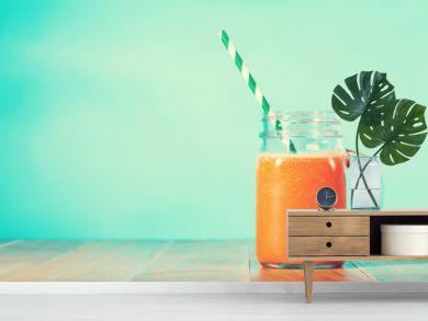 Carrot juice in masons jar