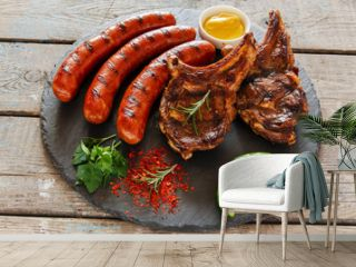 Grilled sausages and steak on the bone barbecue