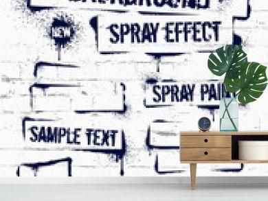 Various Spray paint graffiti on brick wall. Frame with black ink blots. Spray grunge background.