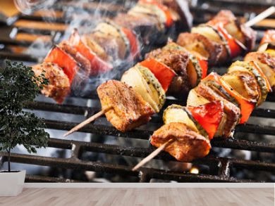 Grilling shashlik on barbecue grill