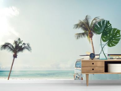 Vintage car parked on the tropical beach (seaside) with a surfboard on the roof - Leisure trip in the summer