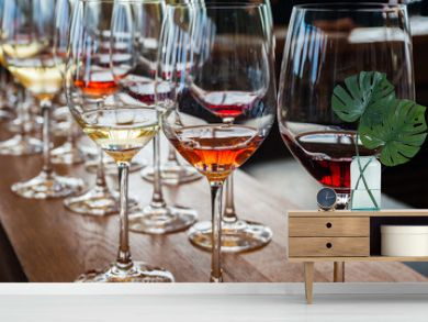 Three wine glasses with samples on wood counter