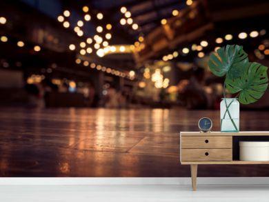 Empty wood table top on blur cafe restaurant in dark background