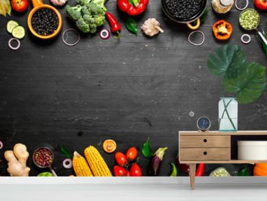 Frame of organic food. Fresh raw vegetables with black beans.