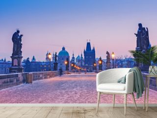 Charles bridge, Prague, sunrise scene, Winter season, snowy weather. Christmas time.