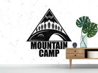 Black emblem with the wood, tent and the mountain, vintage effect attritions. For travel the campground