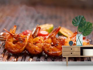 Fresh hot grilled shrimp skewers on the grill