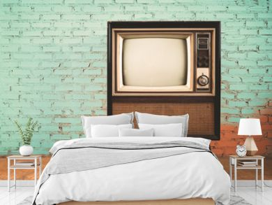 Retro old television in vintage wall pastel color background