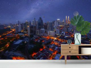 Kuala lumpur nightscape with milky way and supermoon, Malaysia.