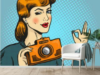 Vector illustration of woman taking photo in pop art style.