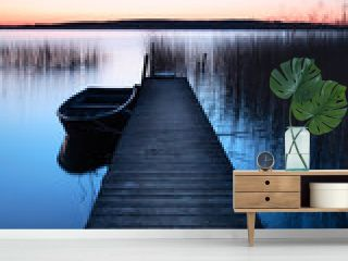 Calm Lake at Sunrise, Wooden Pier with Fishing Boat