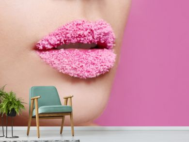 Lips of beautiful young woman covered with sugar on color background