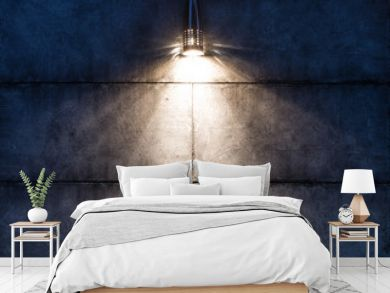 Background image of a dark wall with a lamp