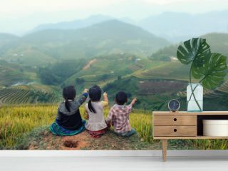 Three children looking forward on the top of terraced of rice field at Vietnam.Together concept.