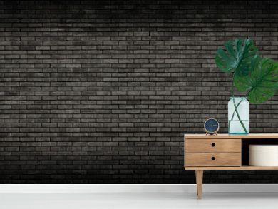 Black brick wall panoramic background.