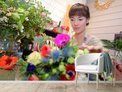 Female florist behind flowers