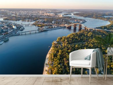Aerial top view of Kyiv skyline, Dnieper river and Truchaniv island from above, sunset in Kiev city, Ukraine