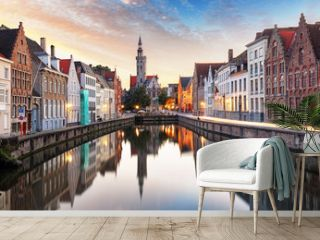 Bruges, Belgium - Scenic cityscape with canal Spiegelrei and Jan Van Eyck Square