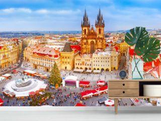 Prague. Panoramic aerial view of Chrismtas market. Seasonal winter scenery in sunny day.