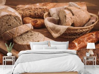 Various baked breads and rolls on rustic wooden table