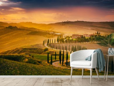 Beautiful Tuscany at sunset after rain. Autumn in Crete Senesi with cypress trees. Italy, Europe