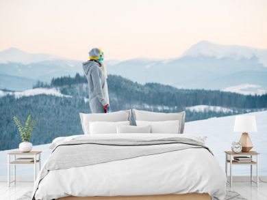Female snowboarder enjoying skiing in mountains in the evening on the slope at winter ski resort in the mountains copyspace stunning view scenery landscape recreation concept