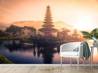 Pura Ulun Danu Bratan, Hindu temple on Bratan lake landscape with lens flare at sunrise in Bali, Indonesia.