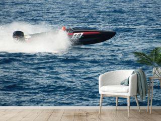 Speed boat cruising in the ocean,boat race