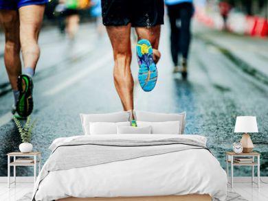 water sprays from under running shoes runner men