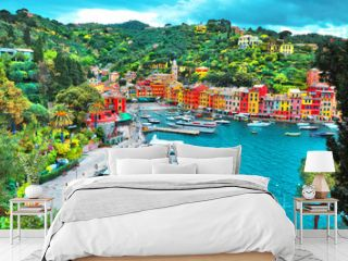 PORTOFINO , ITALY - MAY 02, 2016: The beautiful Portofino with colorful houses and villas, luxury yachts and boats in little bay harbor. Liguria, Italy, Europe