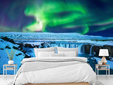 Northern Light, Aurora borealis at Godafoss waterfall in winter Iceland.