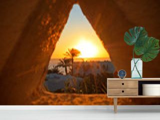 View of the sunset through a triangular hole in Sharm-el-Sheikh, Egypt