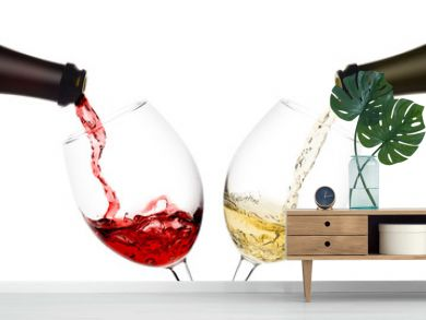 red and white wine poured from a bottle into wine glass on white background, isolated