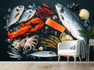 Fresh fish and seafood arrangement on black stone