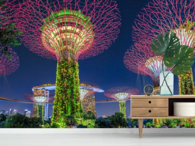 Panorama of Gardens by the Bay with colorful lighting at blue hour in Singapore, Southeast Asia. Popular tourist attraction in marina bay area.