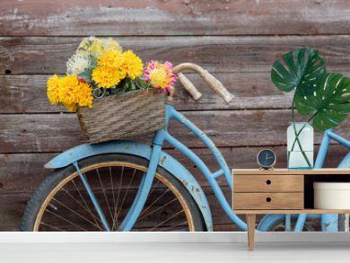 Vintage blue bike on wood background