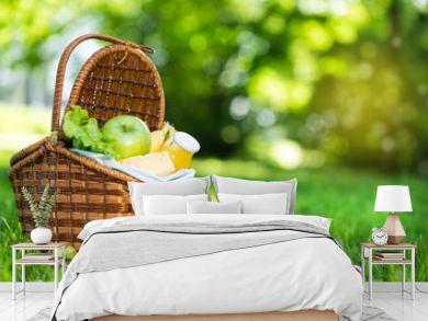 Picnic basket with vegetarian food in summer park