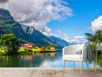 Amazing nature view with fjord and mountains. Beautiful reflection. Location: Scandinavian Mountains, Norway. Artistic picture. Beauty world. The feeling of complete freedom