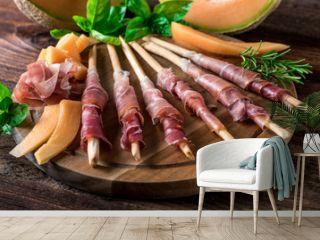 Italienische Jause - Buffet - Prosciutto - Rohschinken - Schinken - Zuckermelone - Melone - Grissini