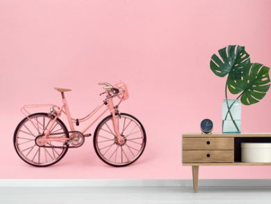 Pink vintage bicycle on pink background. pastel minimal style concept.