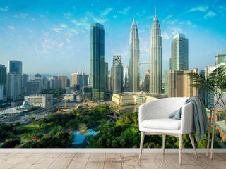 Cityscape of Kuala Lumpur Panorama at sunrise. Panoramic image of skyscraper at Kuala Lumpur, Malaysia skyline with blue sky.