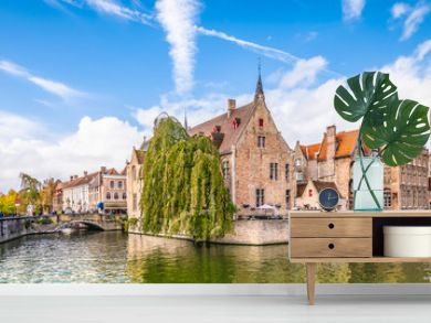Panoramic city view with historical houses, church, Belfry tower and famous canal in Bruges, Belgium.