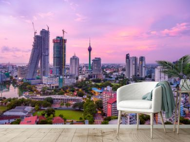 Colombo Sri Lanka skyline cityscape photo. Sunset in Colombo with views over the biggest city in Sri Lanka island. Urban views of buildings and the Laccadive Sea