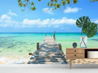Long wooden bridge go to the sea in beautiful tropical island, Thailand.