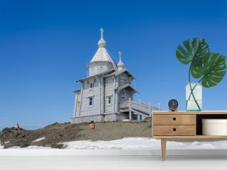 Wooden church in Antarctica on Bellingshausen Russian Antarctic research station and helicopter