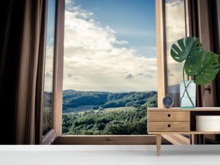 Panoramic view of the rolling hills of Chianti through a window in early morning