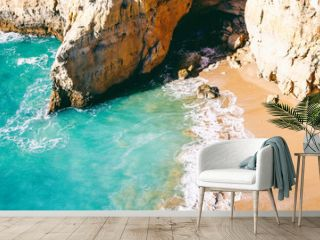 Panoramic view of a beautiful stunning beach with turquoise water and rocks, view from above, the Algarve, Portugal is a popular destination for tourism and travel