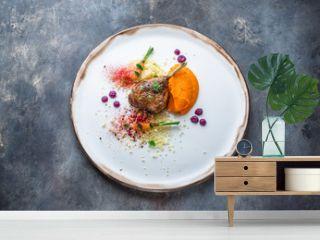 Duck leg confit with batat puree, carrots and couscous, restaurant meal