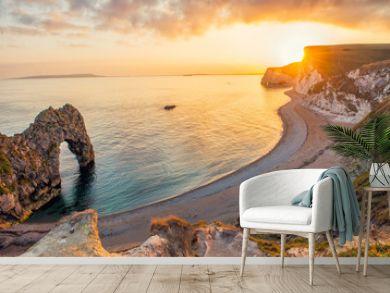 Landscape of empty Durdle Door beach at Sunset. Dorset England.