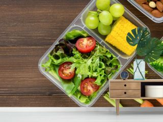 Healthy ready to eat food in meal boxes on wood banner background